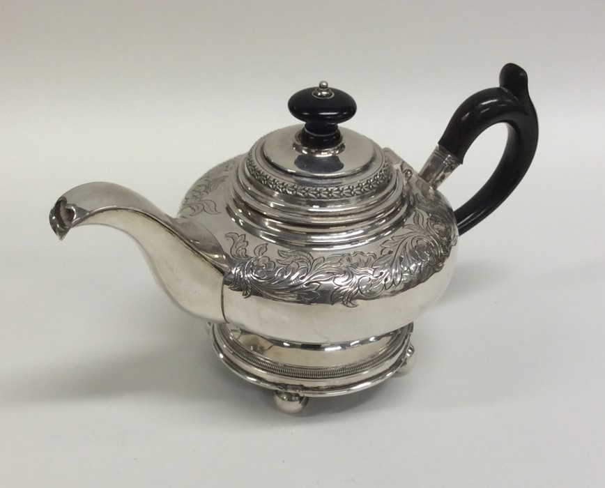 Lot 17 - A good quality Danish silver teapot decorated with