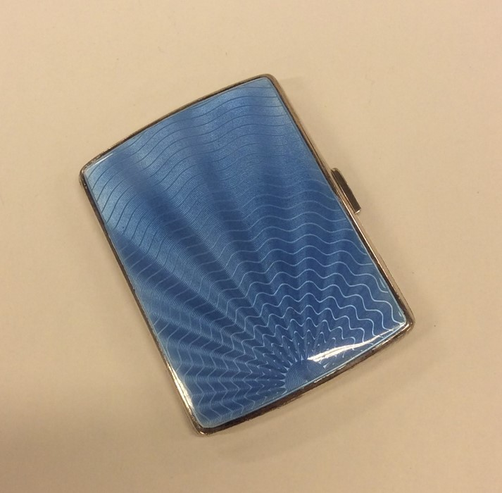 Lot 2 - A silver and enamel cigarette case with hinged top