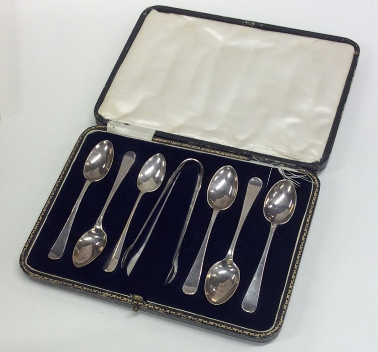 Lot 37 - A set of six silver teaspoons and tongs in fitted