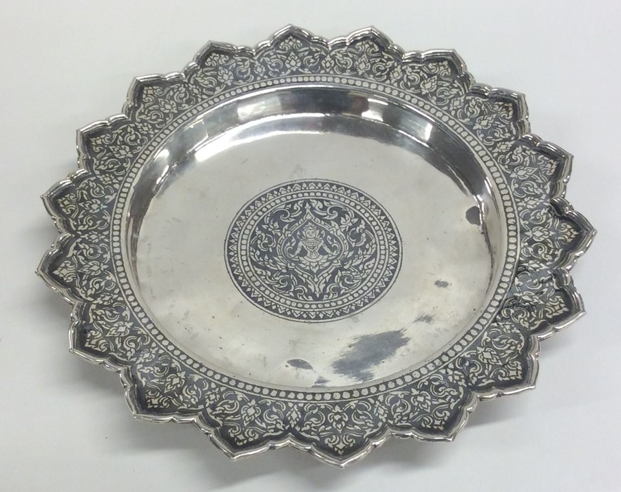 Lot 38 - A circular Persian silver shallow dish with shaped