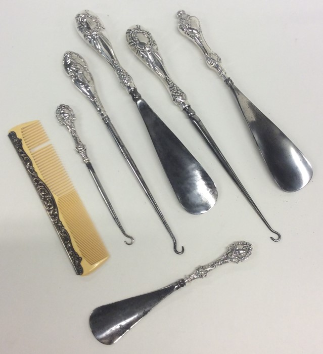 Lot 4 - A silver mounted button hook and a shoe horn, toge