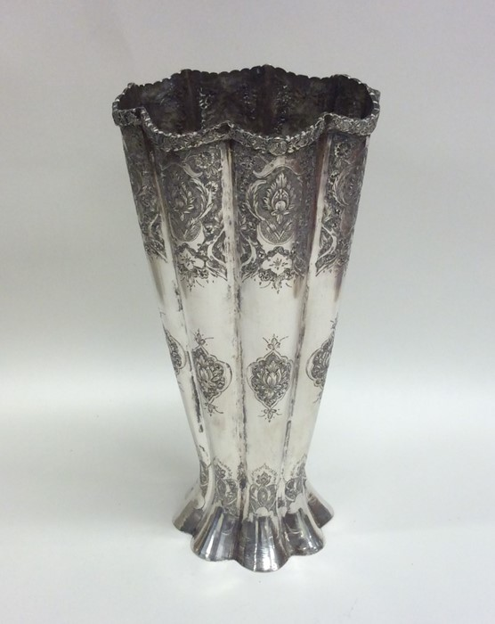 Lot 26 - A tall tapering Continental silver vase with shape