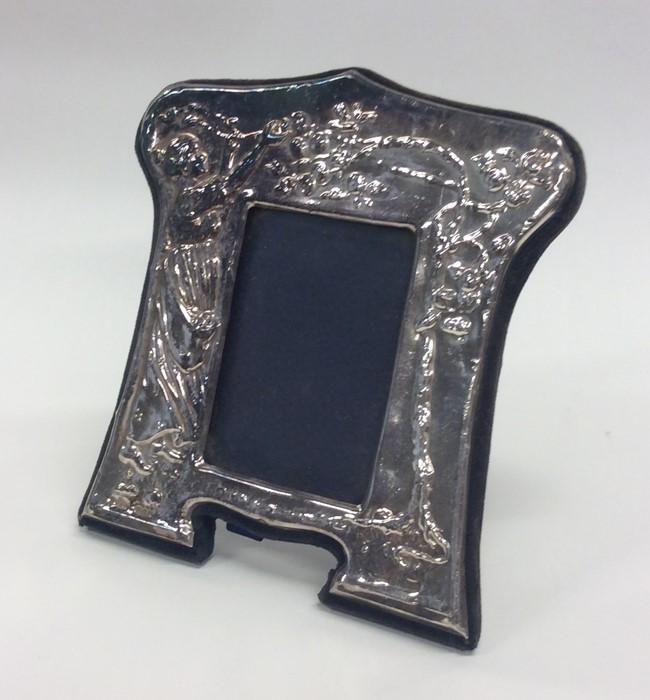 Lot 3 - A stylish silver modern picture frame on bracket f