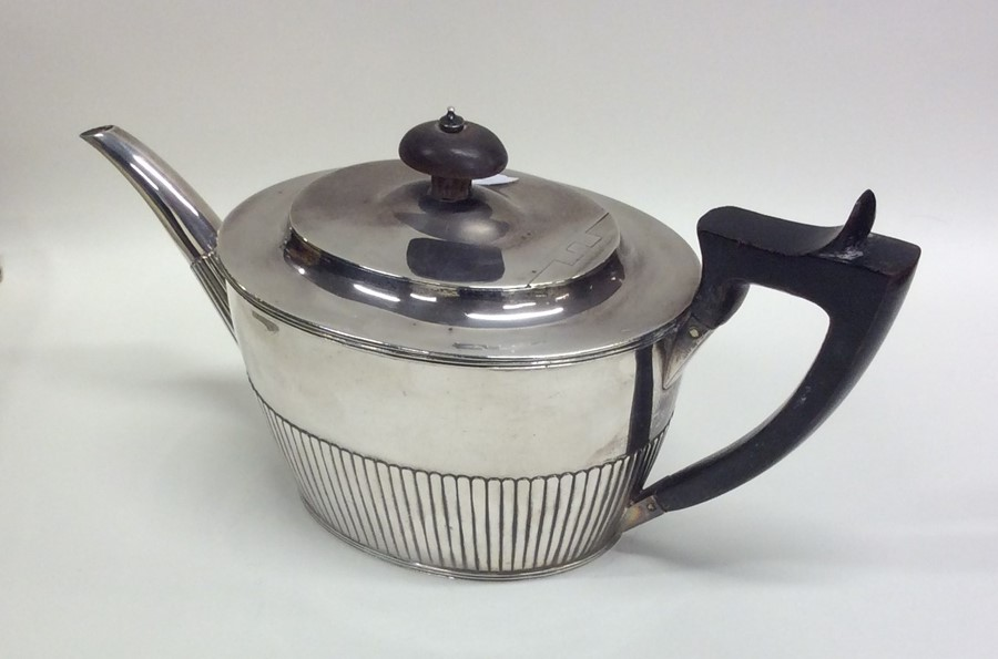 Lot 29 - A good quality Victorian silver teapot with hinged