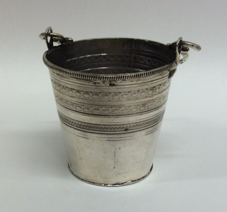 Lot 8 - A Continental tapering silver pail with scroll dec