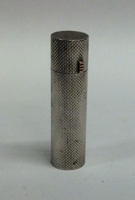 Lot 35 - A good quality silver lipstick holder of cylindric