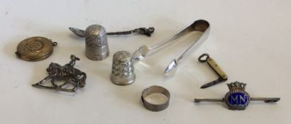 A bag containing silver thimbles, brooches etc. Ap