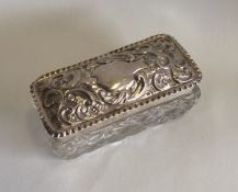 A rectangular hobnail cut silver box with lift-off