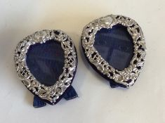 CHESTER: A pair of heart shaped silver mounted pic