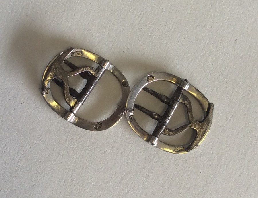 Lot 12 - A pair of small Georgian silver buckles. London. A