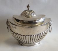 A Victorian silver Adams' style tea caddy with lio