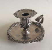 A good Victorian silver chamber stick with crested