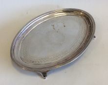 A Georgian oval silver teapot stand. London. By JE