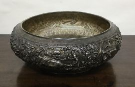 A good quality large Indian silver bowl decorated