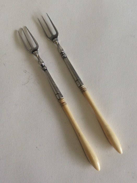 Lot 11 - A pair of Antique silver pickle forks of tapering