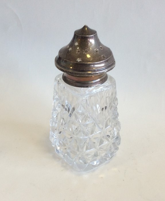 Lot 22 - An Edwardian silver and glass mounted caster. Est.