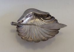 An Edwardian silver butter dish together with matc