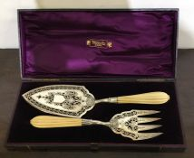 A good Victorian boxed pair of silver fish servers