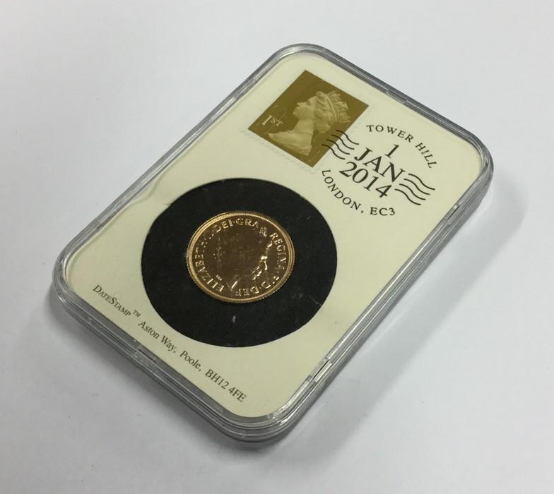 Lot 1 - A 2014 proof full sovereign. Est. £250 - £350.