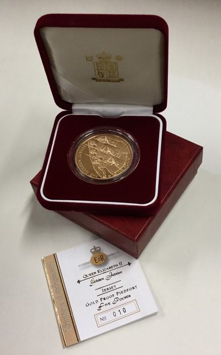 Lot 16 - A Queen Elizabeth II Jersey proof £5 gold coin. Es