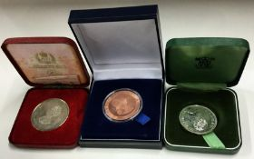 Three cased nickel commemorative coins. Est. £10 -