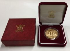 A Queen Elizabeth II Guernsey proof £5 gold coin.
