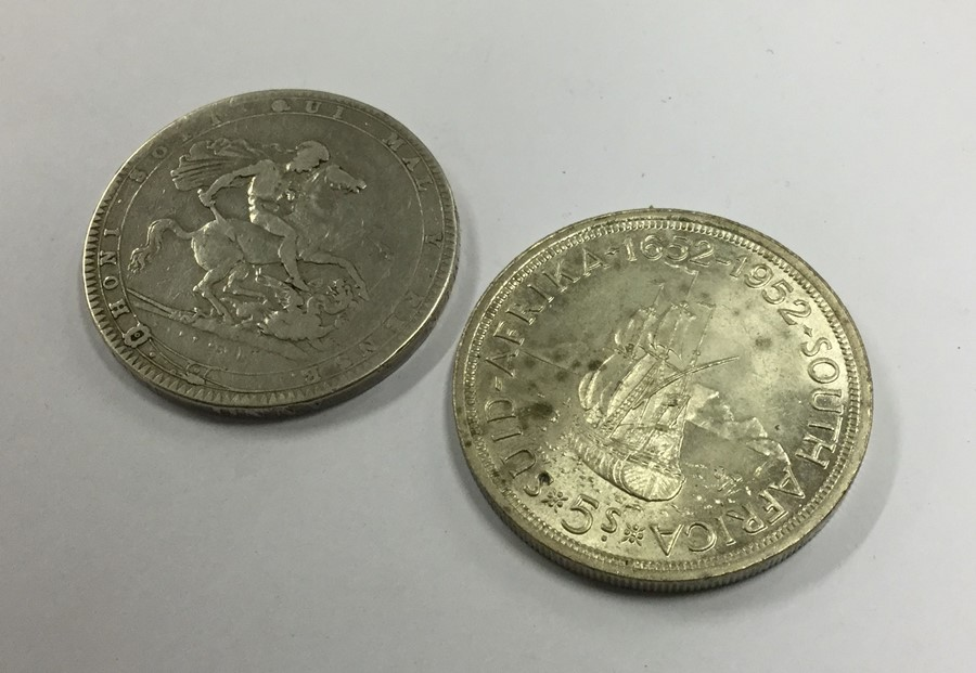 Lot 7 - A George III silver Crown together with a South Af
