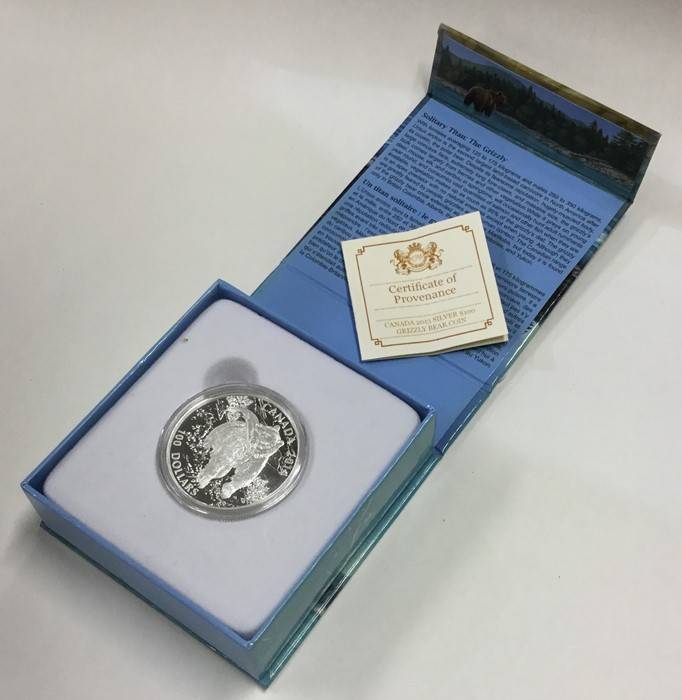 Lot 11 - A cased proof silver Canadian $100 coin. Est. £10