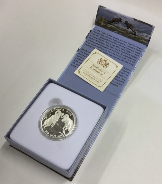 Lot 12 - A cased proof silver Canadian $100 coin. Est. £10