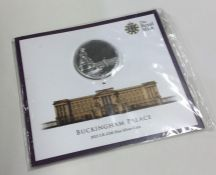 A proof Royal Mint Buckingham Palace £100 coin in