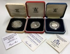 A proof silver Prince of Wales coin together with