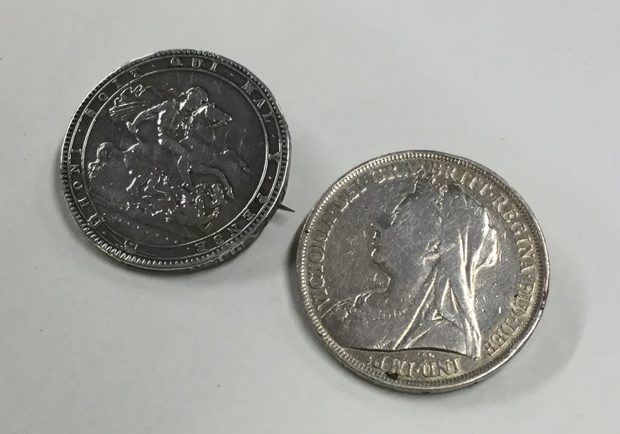 Lot 23 - Two silver Crowns mounted as brooches. Approx. 55