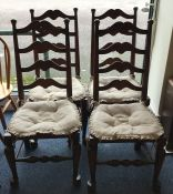 A set of four oak ladder back chairs with turned s