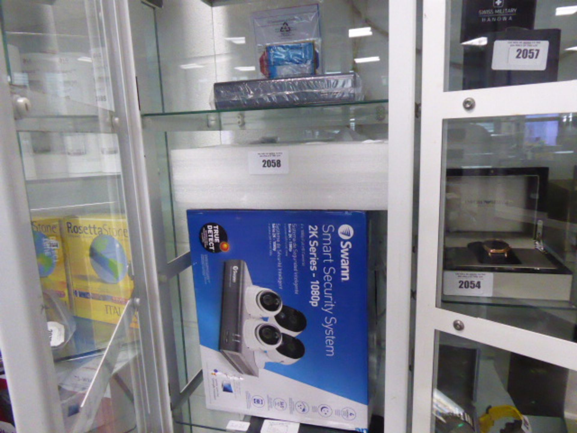 Lot 2058 - Swann Smart security CCTV system 2K series, with 4 cameras, adapters, power supplies and recorder