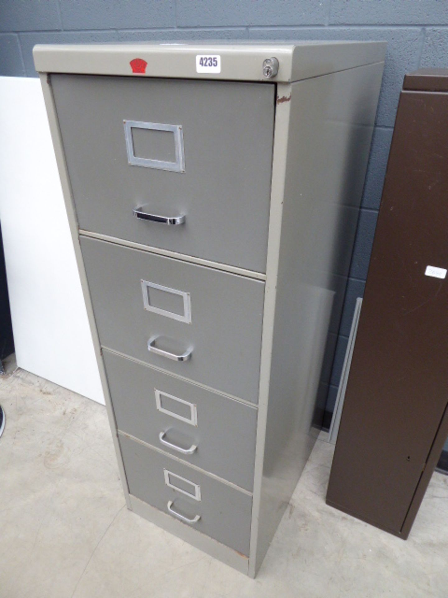 Lot 4235 - Grey metal 4 drawer filing cabinet