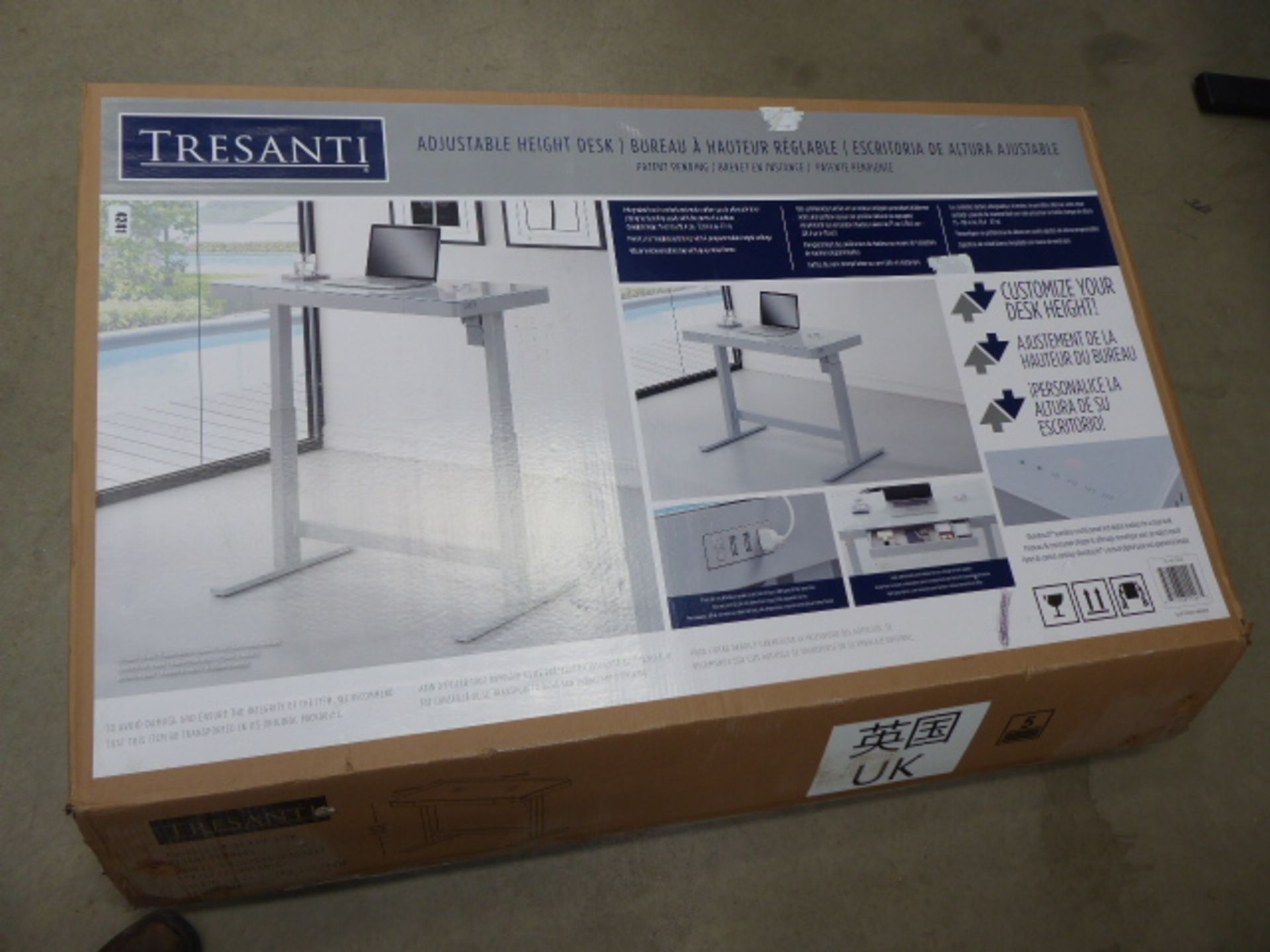 Lot 4241 - Boxed flat pack rise and fall desk with smashed glass top