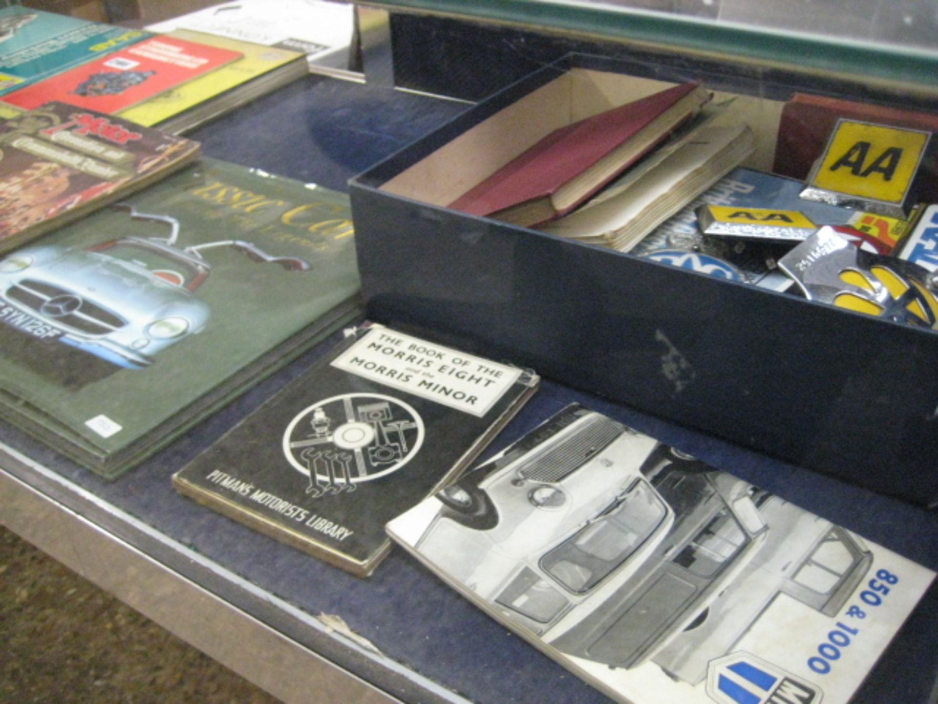 Lot 2186 - Quantity of classic car catalogues and annuals with quantity of motoring badges, etc.