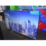 (R57) Hisense 65'' TV model number H65B7500UK with remote and box B104