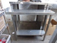 A 20cm stainless steel infill table