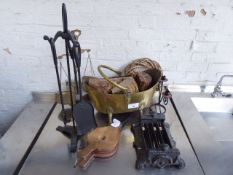 Tabletop of display items including boot scrape, mini bellows, coal scuttle, balance scales etc
