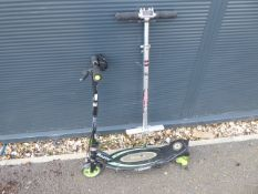 Small green and black Razor electric scooter and pogo stick