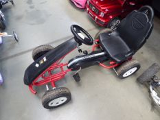 Keter red and black 4 wheeled go-kart