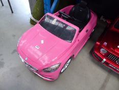 Pink AMG child's electric BMW