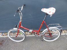 Red vintage ladies folding cycle with love heart saddle