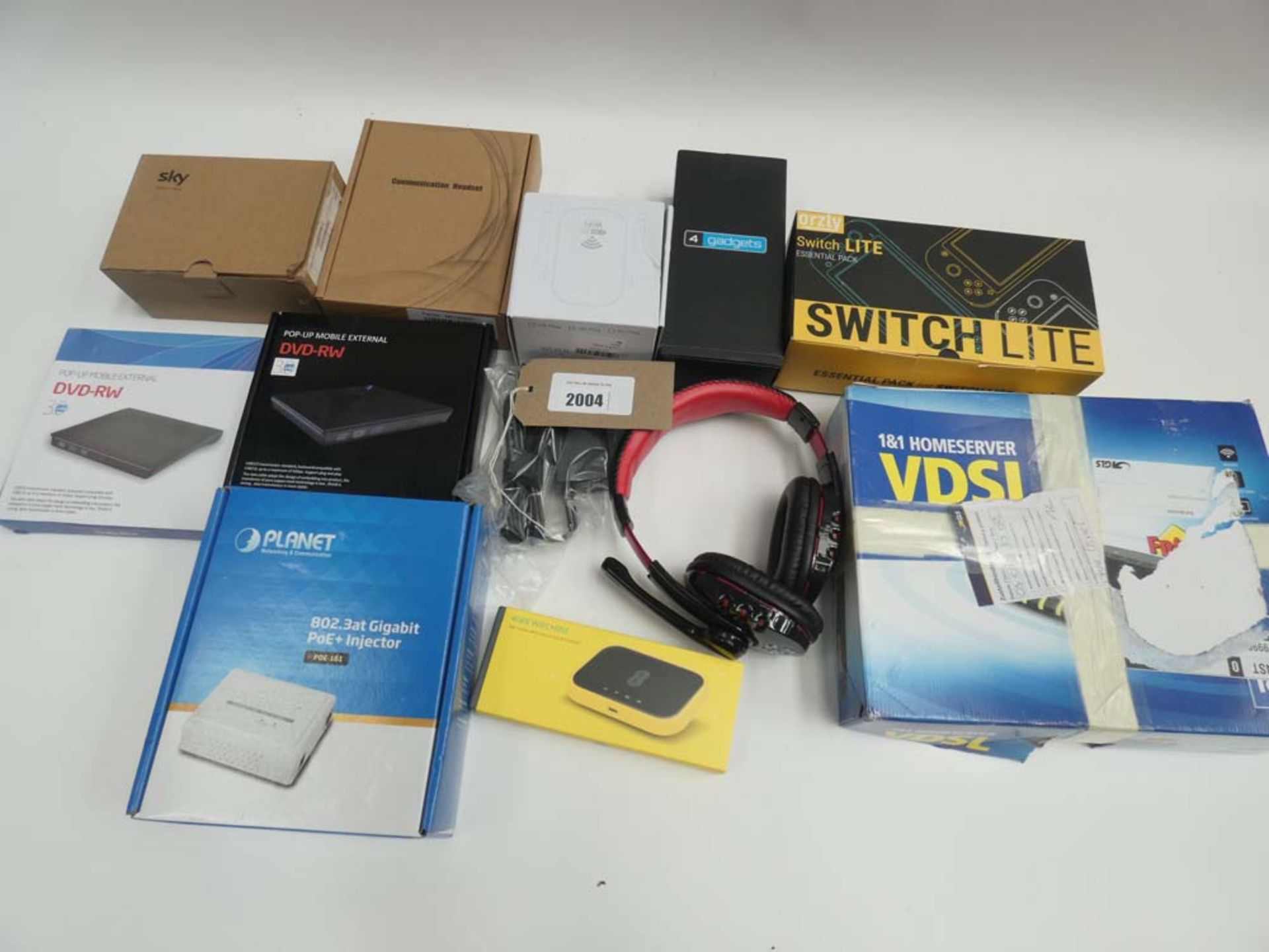 Lot 2004 - Bag containing external DVD drives, headsets, Switch Lite case, WiFi accessories etc
