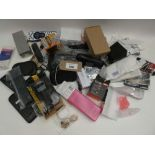 Bag containing quantity of various electrical related items; remote controls, adapters, PSUs,
