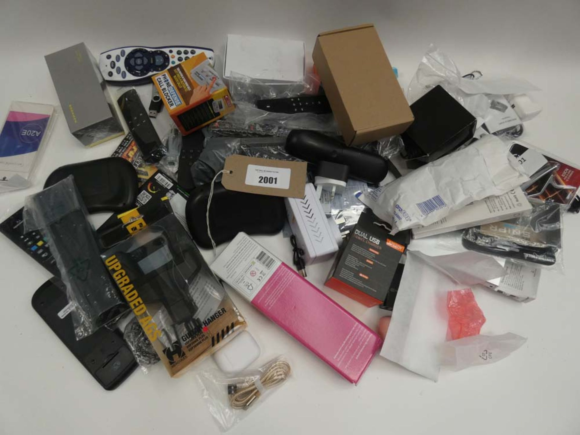 Lot 2001 - Bag containing quantity of various electrical related items; remote controls, adapters, PSUs,