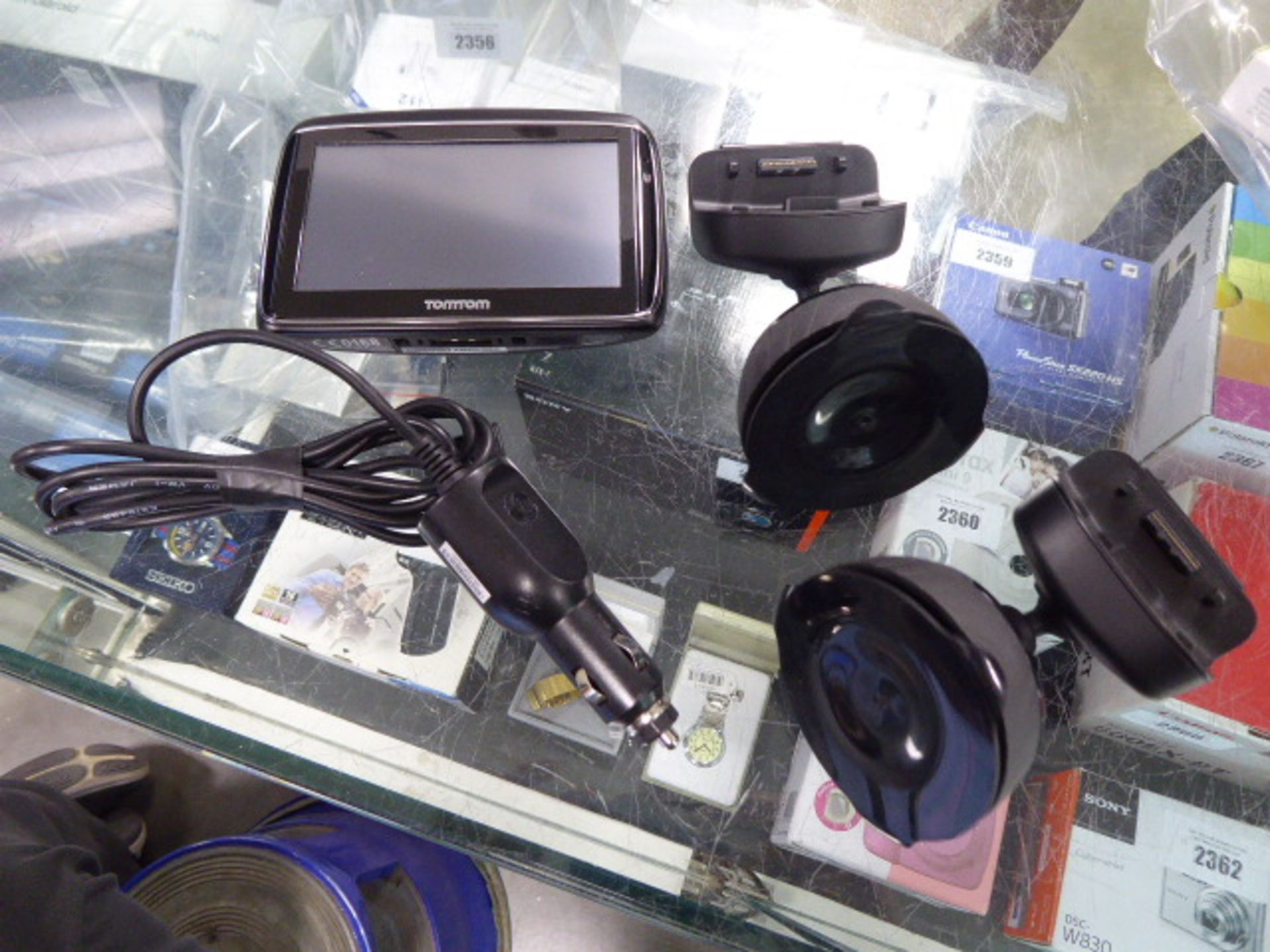 Lot 2390 - TomTom and other sat-navs in bag with accessories