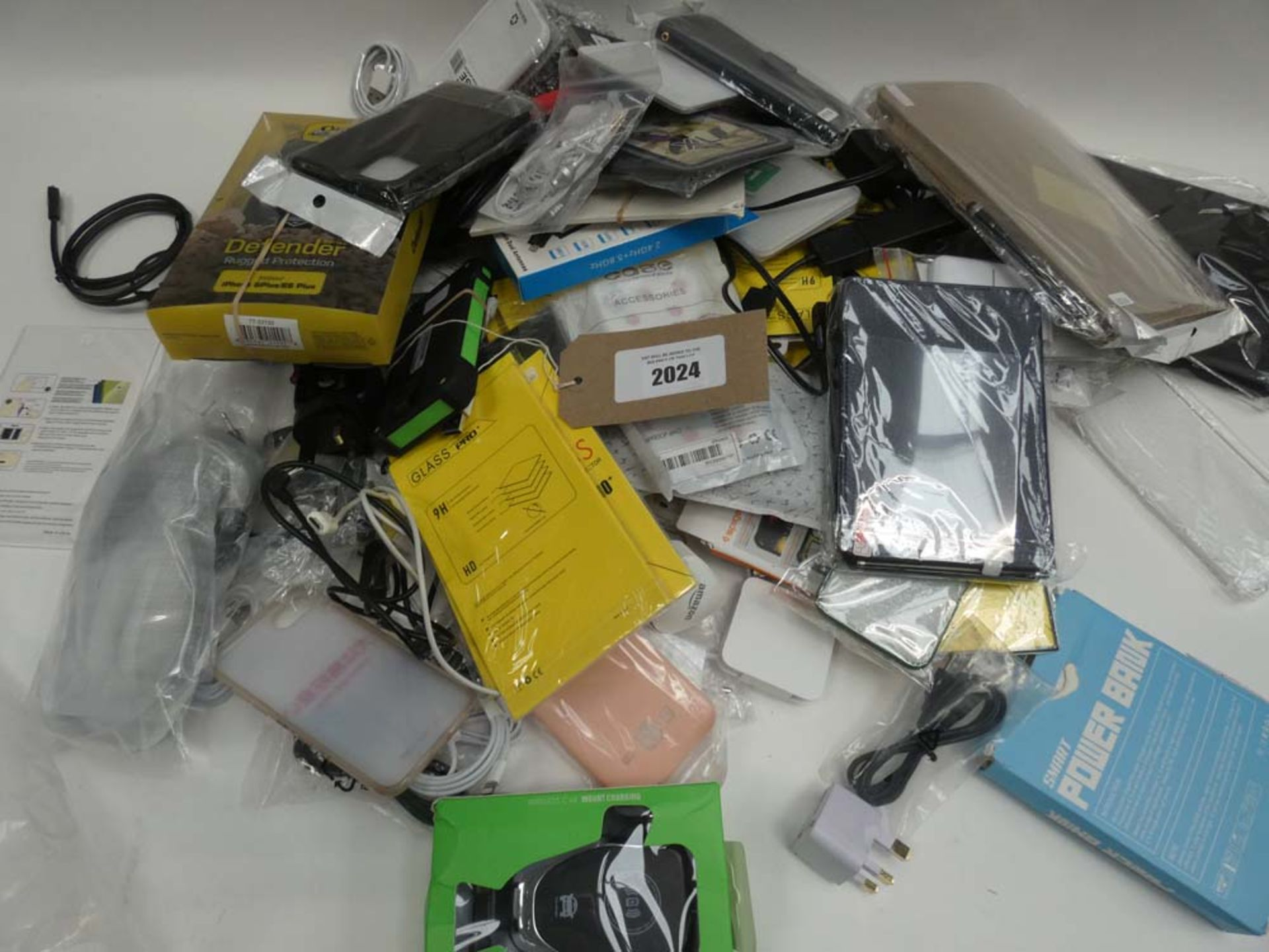 Lot 2024 - Bag containing quantity of various mobile phone accessories; cases, covers, cables, adapters,