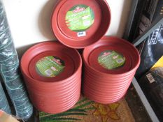 Quantity of circular flower pot trays
